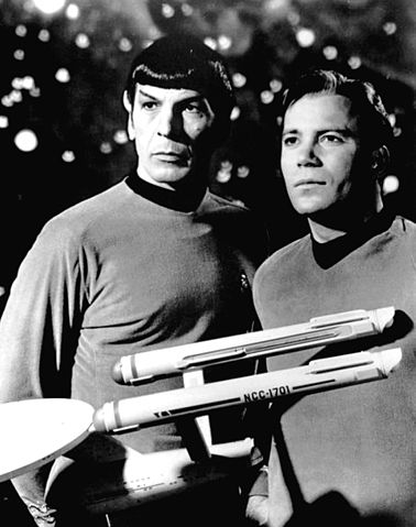 Kirk and Spock and model of the Enterprise